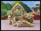 Le porche et mur en pierres ATELIER DE FANNY - Fabricant à - Santons et Crèches