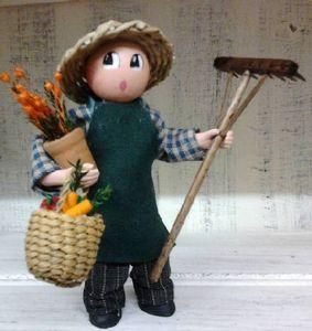Le jardinier au rateau