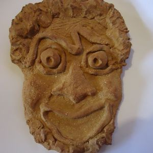 Masque en grès grec